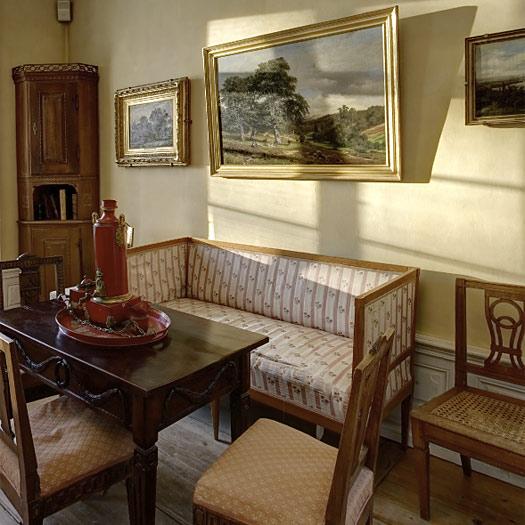 Eckzimmer mit Empire Möbeln
